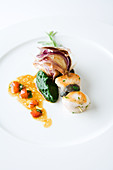 Rabbit and snail skewers with nettle puree and carrots