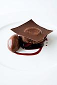 Warm chocolate tart with port wine cherries