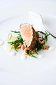 Salmon with a spice crust on salicornia