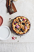 Plum cake with edible flowers