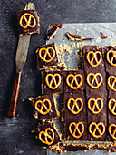 Bars with chocolate icing and salt pretzels