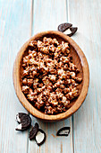 Popcorn with oreo biscuit coating in a wooden bowl