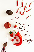 Mix of fruits and vegetables in red color on white background
