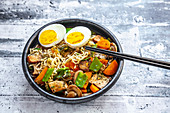 Ramen soup with vegetables, mushrooms, smoked tofu and egg