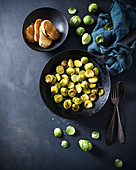 Oven-baked brussels sprouts with salt flakes and cress, and baguette slices