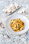 Risotto of mushrooms, sardines, Fregola noodles and thyme