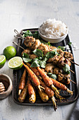 Thai marinated chicken with rice and roasted carrots with orange, cumin and honey