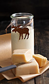 Homemade marzipan liqueur with cream and white rum