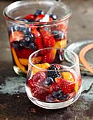 Homemade rum punch with berries and apricots