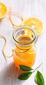 Homemade orange syrup with fresh fruits