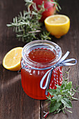 Homemade lemon and apple syrup with fresh herbs