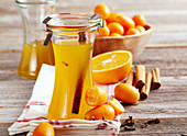Homemade kumquat and orange syrup with spices