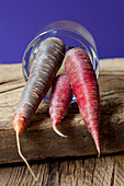 Red and purple carrots in a glass
