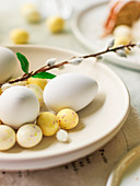 White eggs and chocolate Easter eggs