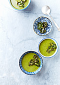 Cream of vegan Kale-Broccoli Soup with Kale Chips. Seen from above