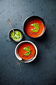 Roasted red pepper and tomato soup with spinach and wild garlic pesto