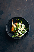 Oven-roasted quail with a Chinese cabbage and coconut salad
