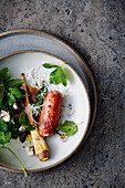 Salsiccia with ground-elder salad, daisies and parsley root
