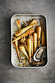 Oven-roasted parsnips with oysters and pine nuts