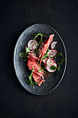 Watermelon salad with ice plant and red radishes