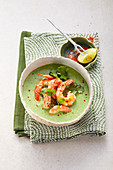 Broccoli and coconut soup with shrimps