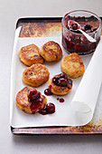 Quarkkeulchen (potato and quark cakes) with cherry compote