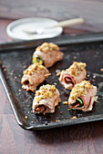 Stuffed pork tenderloin rolls with a crunchy crust