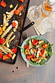 Rocket salad with grilled vegetables and halloumi
