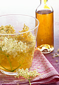 Homemade elderflower liqueur with fresh flowers