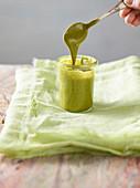 A jar of pistachio mousse