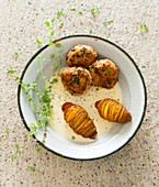 Meatballs with a marjoram and white wine sauce served with hasselback potatoes