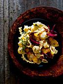 Mafaldine with porcini mushrooms and red wine onions