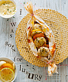 Chicken and lemon meatballs in parchment paper