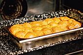 Buchteln (baked, sweet yeast dumplings) in an oven