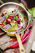 Purple potato ragout with beetroot, chard and allspice