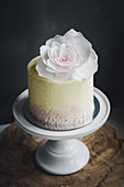A restive mini cake decorated with a rose
