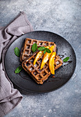 Fresh waffles with bird cherry flour, mango and mint