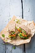 A sandwich with halloumi and microgreens