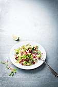 Millet salad with chard and pomegranate seeds