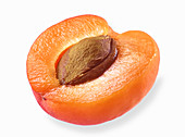 Half an apricot on a white surface