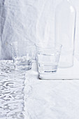 Two glasses of water and bottles