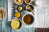 Various types of mustard in bowls