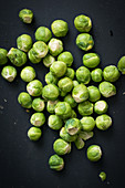 Fresh Brussels sprouts on a black background
