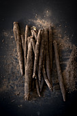 Fresh black salsify on a dark surface