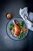 Roasted duck leg with wild broccoli and apricot compote