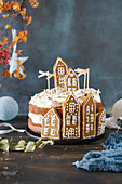 A Christmas cake decorated with gingerbread houses