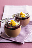 Tonka bean and mango mousse au chocolat with warm blackberry sauce