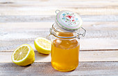 Lemon syrup with honey in a preserving jar
