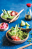 Sushi bowl with salmon, avocado, cucumber and broccoli rice