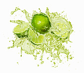 Limes with a juice splash